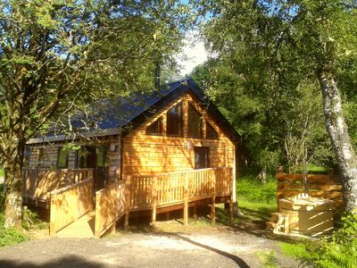 Photo for Charming, Well Equipped Log Cabin with wood fired hot tub