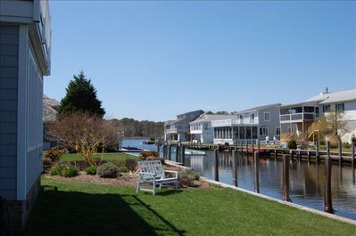 Back Yard Canal View, large beautiful landscaped open space w/ dock