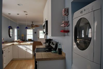 Kitchen with brand new front load washer and dryer