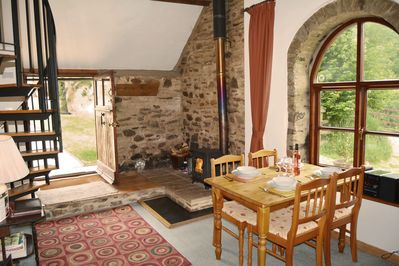 Ground floor: Dining area in the open plan living space with wood burner