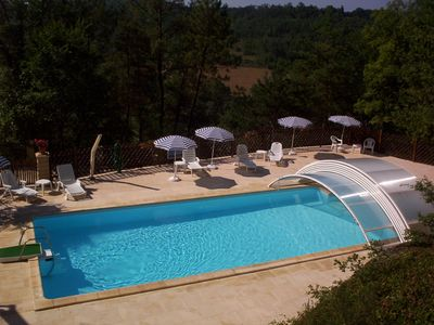 Photo for 4 beautiful Perigordian houses, stone with a large heated pool.