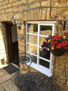 Summer basket outside Captains Cabin frontage, enjoy a glass of wine in the sun
