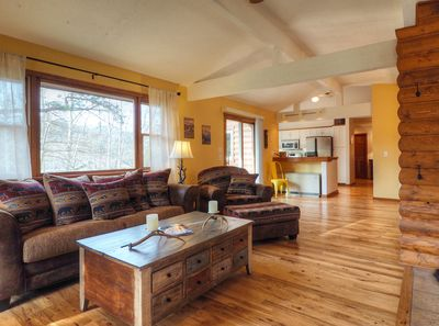 Lazy Elk Retreat - The cabin features an open concept great room, dining area and kitchen