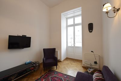 Living area and door to the balcony in the square