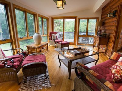 Photo for Modern classic log home on16acres, hot tub, fire pit, own creek, pond & trails!