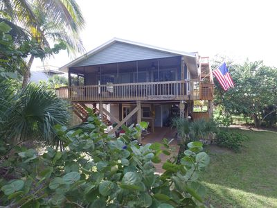 Photo for Coconut Palace -A Peaceful Serenity. Close to bay & gulf with dock & beach path