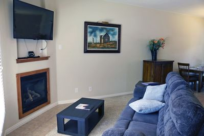Living room has gas fireplace and TV