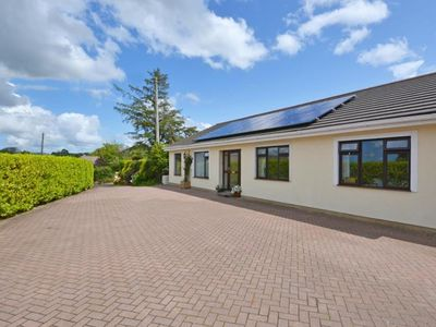 Photo for Detached holiday home with cosy interior, large garden and unique BBQ hut