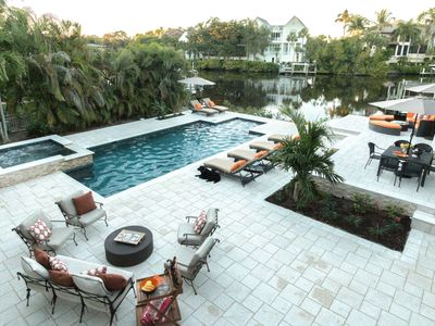 Photo for Professionally Decorated Waterfront Home w/htd.pool,spa, dock- less than 2 miles to Barefoot Beach!