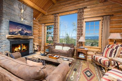 Greatroom lounge, wood burning fireplace, 60' smart HDTV