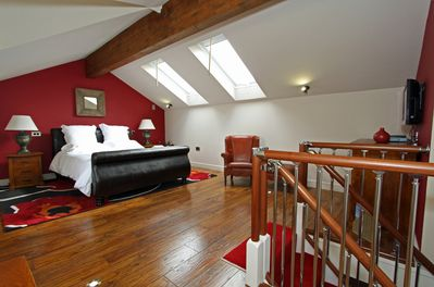 Luxury King-size bed in a very spacious bedroom!