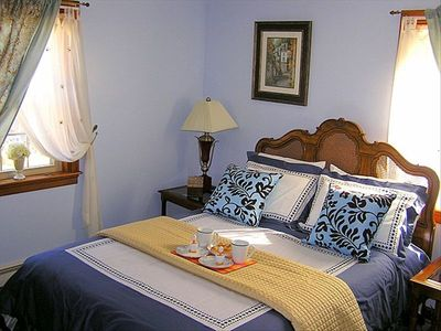 Downstairs bedroom has a king bed and a large sitting area with couch and TV