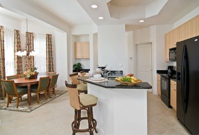 Plenty of seating and a gorgeous open kitchen!