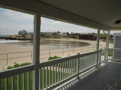 View from front porch that has six large rocking chairs