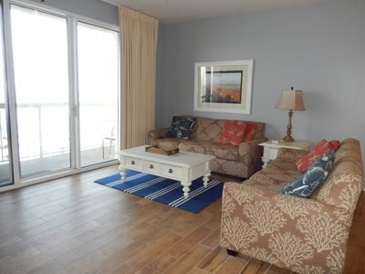 Relax with 2 full size sofas...(and new flooring)
