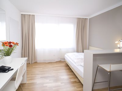 Photo for Serviced apartment with WiFi, cleaning and underground parking space
