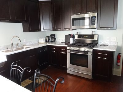 Kitchen with updated stainless steel appliances and dishwasher!