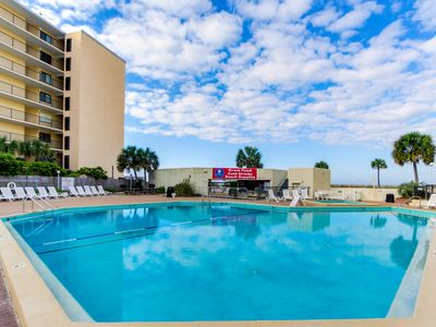 Photo for Beachfront condo w/ resort pool and fitness center!