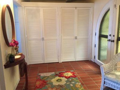 Bright entrance foyer with washer/dryer stored in closet.  Pack light!