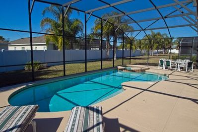 Pool with spa, loungers and covered lanai