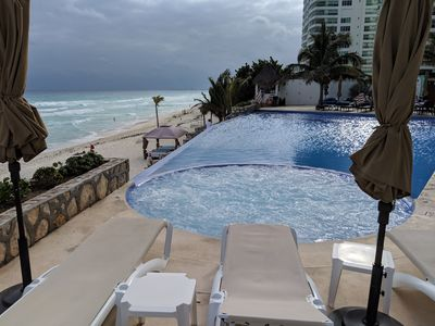 Upper infinty pool wih great views of beach. Beach massage tables.