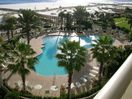 Breathtaking view of pool and beach from balcony