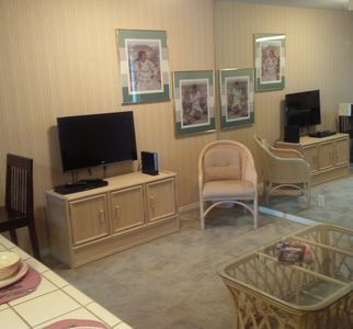 Living Room with free WiFi, Futon, access to Kitchen, dining, and balcony.