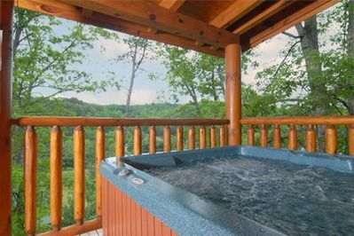 Hot tub on deck w/ mountain view