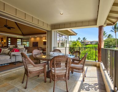 Large open concept indoor living room opens into lanai outdoor living room