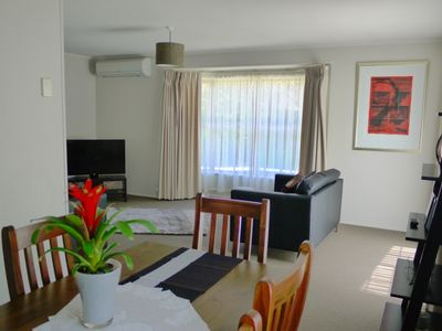 Photo for Central 3 bedroom home, free WIFI ++ hotpools, swimming pool and gym