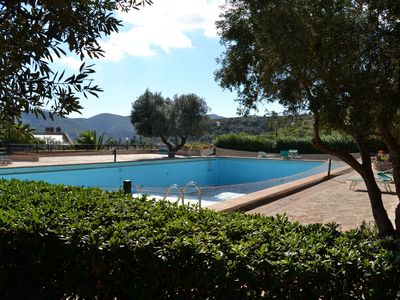 Photo for Large apartment with sea views in a spacious garden with a shared pool
