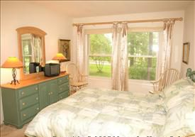 Master bedroom has queen size bed and private full bathroom