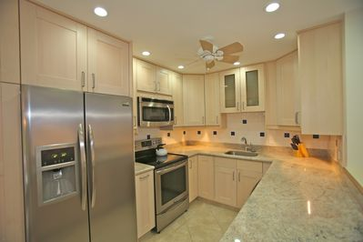 Kitchen - stainless steel appliances, granite counter tops, ceiling fan