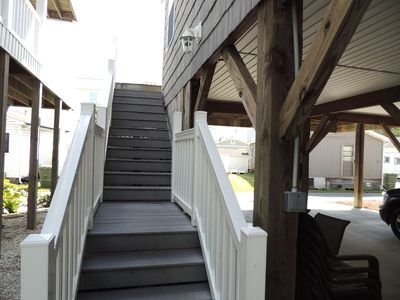 Stairs leading to 1st level deck and front door