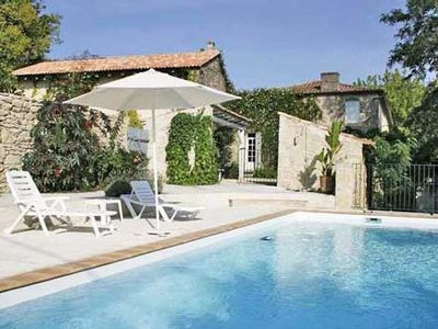 Photo for Peaceful cottage with character and gated pool