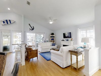 Photo for Waterfront home w/ golf cart & shared pool/hot tub - close to beach