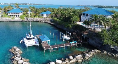 High House and its dock with a 45' , 13' beam catamaran