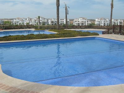 Photo for Luxury Poolside Apartment overlooking 18 hole Golf Course