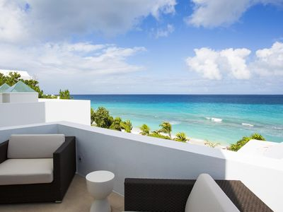 Photo for Beachfront with Private Stairway to Beach, Heated Jacuzzi by Pool, Tennis Courts, Gym