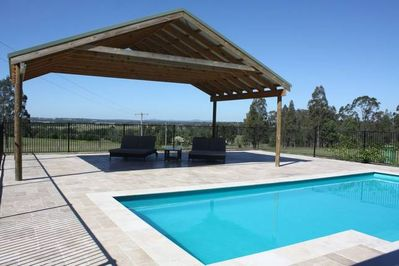 Day beds  next to private pool