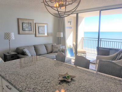 Remodeled kitchen with new peninsula with a great view and plenty of seating.