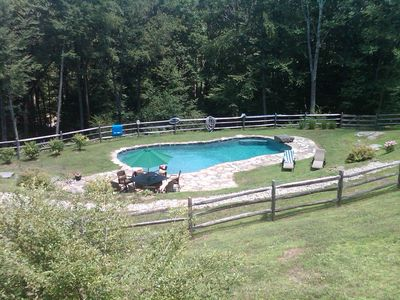 Salt water 40 x 20 gunite and heated pool with fire pit