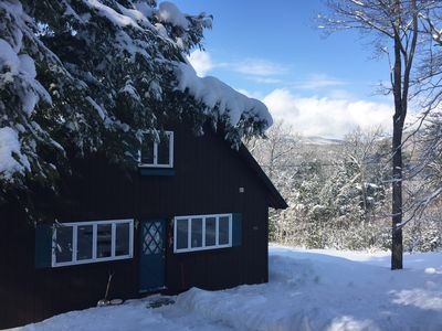Our home with its winter coat.
