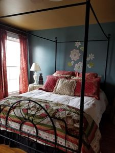Comfortable Queen bed with soft linens, plenty of pillows and down comforter.