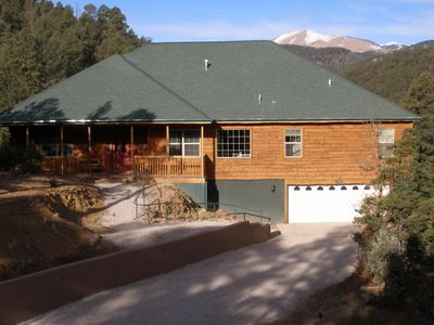 Twin Mountain Cabin with Sierra Blanca in the background