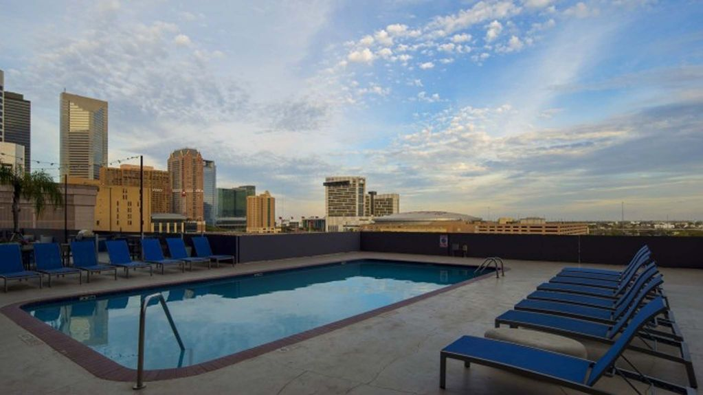 Floor to Ceiling Windows at Cool Downtown Condo with Pool