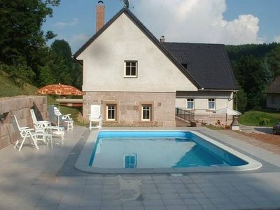 Photo for An attractive apartment with a swimming pool in a farmhouse.