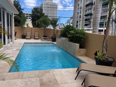 Photo for Condado Paradise with Pool and Walk to Beach