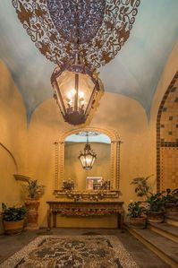 Grand entrance opens to one of two atriums with a fountain