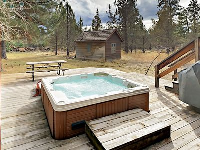 Deck  - Enjoy a private hot tub in your own backyard, perfect for relaxing evenings at home.